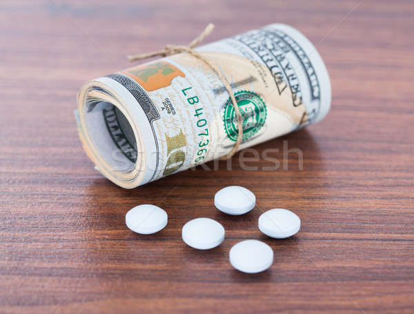 Banknotes By Pills On Table Stock photo © AndreyPopov
