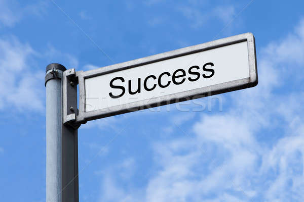 Signpost With Success Sign Against Sky Stock photo © AndreyPopov