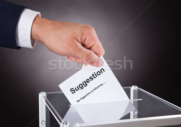 Businessman Placing Suggestion Slip Into Box Stock photo © AndreyPopov
