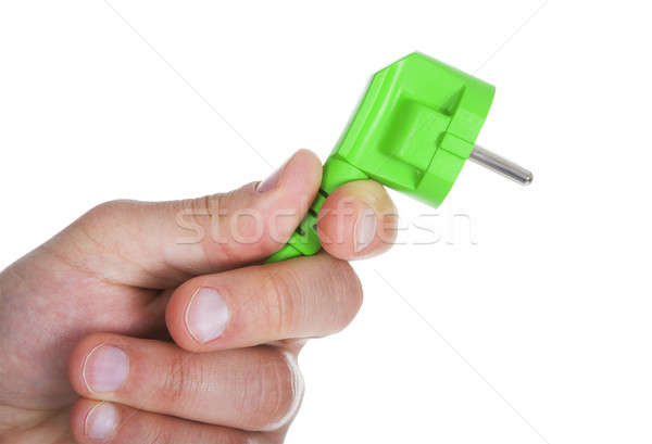 Hand Holding Green Pin Plug Stock photo © AndreyPopov