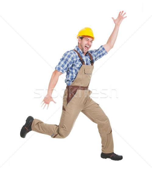 Manual trabajador ejecutando blanco retrato Foto stock © AndreyPopov