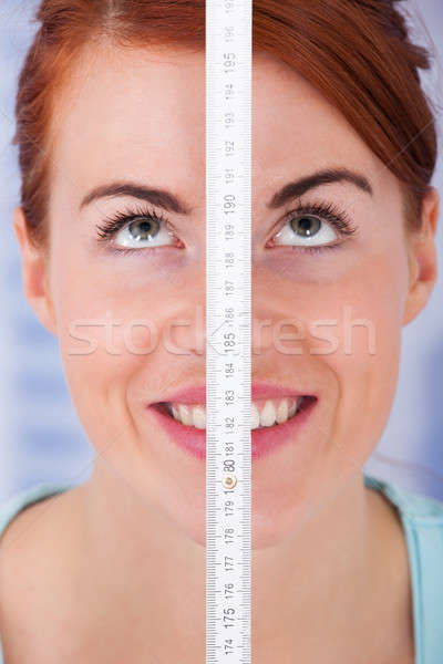 Woman Measuring Height With Measure Tape Stock photo © AndreyPopov