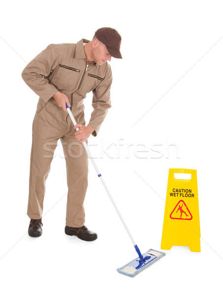 Male Servant Mopping Floor Over White Background Stock photo © AndreyPopov