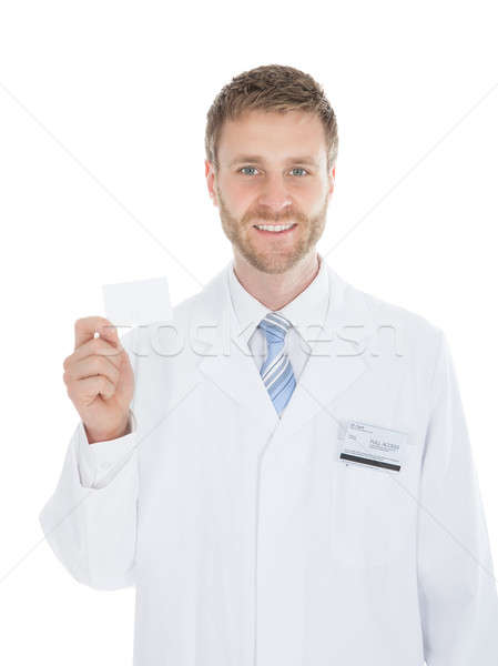 Mid Adult Doctor Holding Blank Visiting Card Stock photo © AndreyPopov