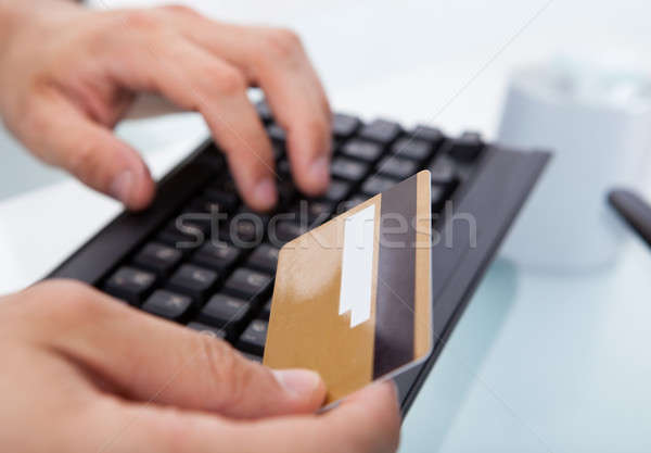 Businessman With Credit Card Shopping Online At Office Desk Stock photo © AndreyPopov