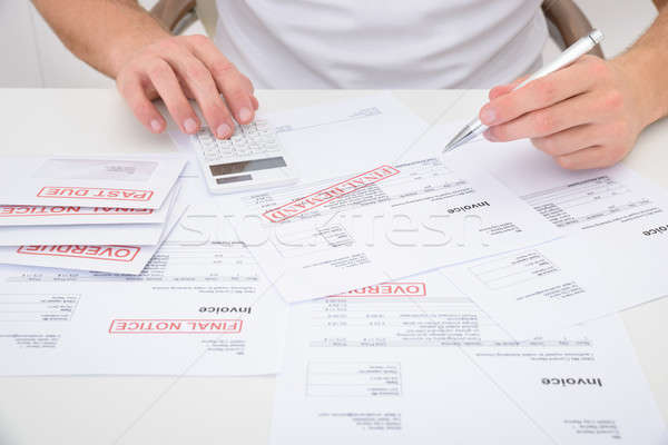 Man Calculating Unpaid Bills Stock photo © AndreyPopov