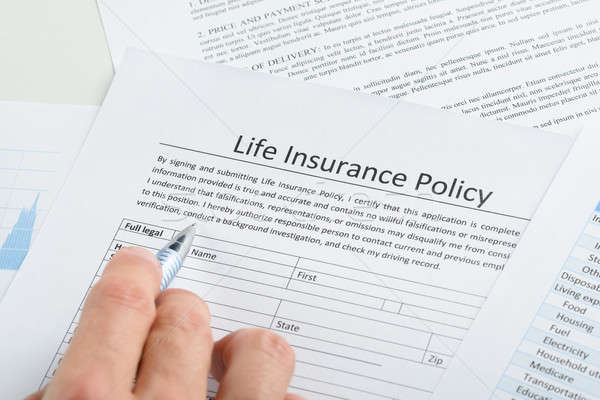 Stock photo: Person Filling Application For Life Insurance