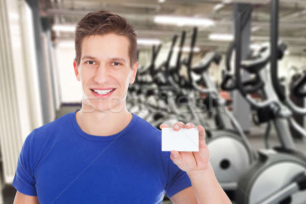 Fit Man Holding Blank Visiting Card Stock photo © AndreyPopov
