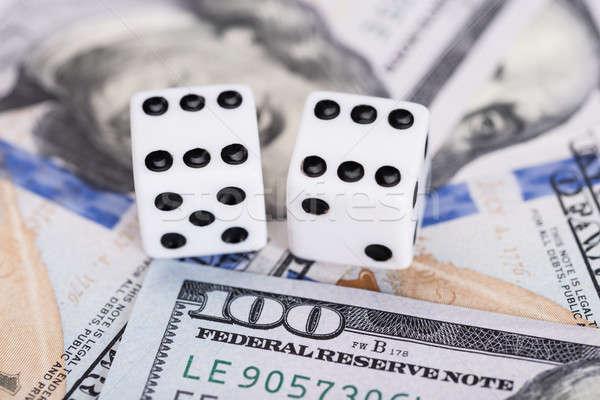 Dollaro valuta gioco d'azzardo soldi dadi contanti Foto d'archivio © AndreyPopov