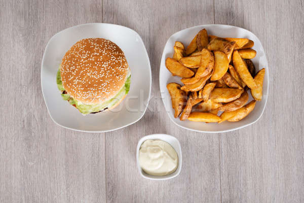 Delicious Burger And Fried Potatoes Served In Plates Stock photo © AndreyPopov