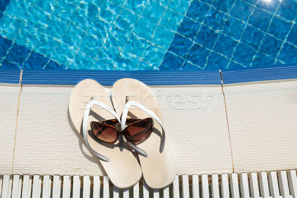 Flip Flops And Sunglasses Beside Swimming Pool Stock photo © AndreyPopov