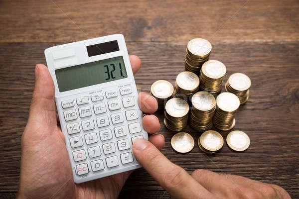 Empresário moedas escritório dinheiro homem Foto stock © AndreyPopov