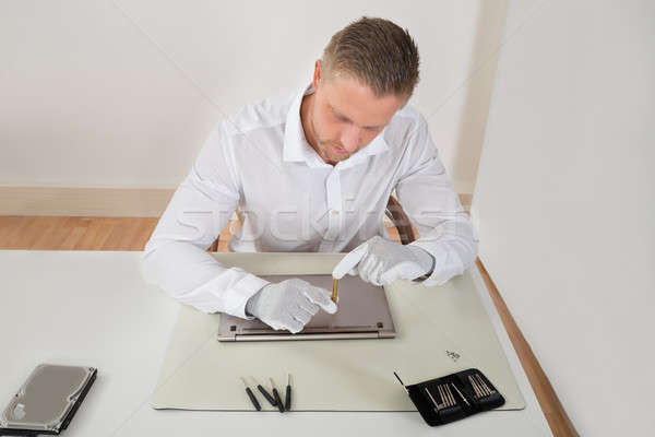 Repairman Repairing Laptop Stock photo © AndreyPopov
