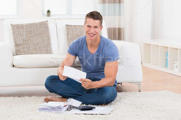 Man Calculating Bills In Living Room Stock photo © AndreyPopov