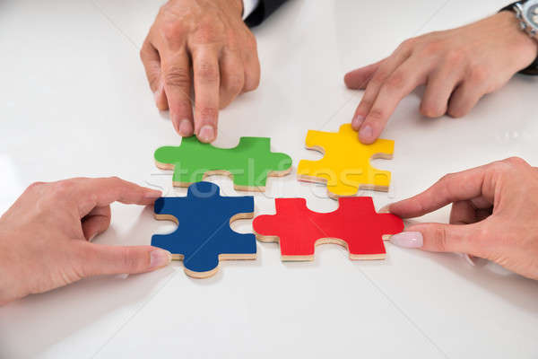 People Assembling Puzzle Pieces Stock photo © AndreyPopov