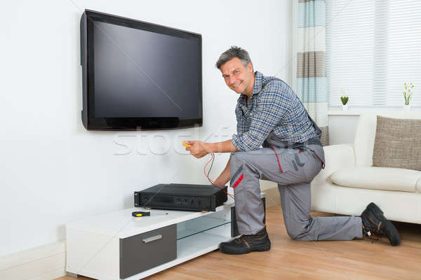 Technician Installing TV Set Top Box At Home Stock photo © AndreyPopov