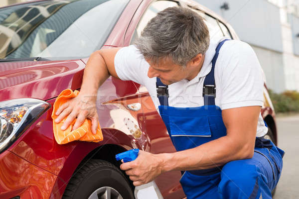 Male Worker Cleaning Red Car Stock photo © AndreyPopov