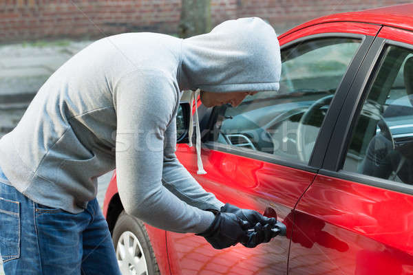 Thief In Hooded Jacket Stealing Car Stock photo © AndreyPopov