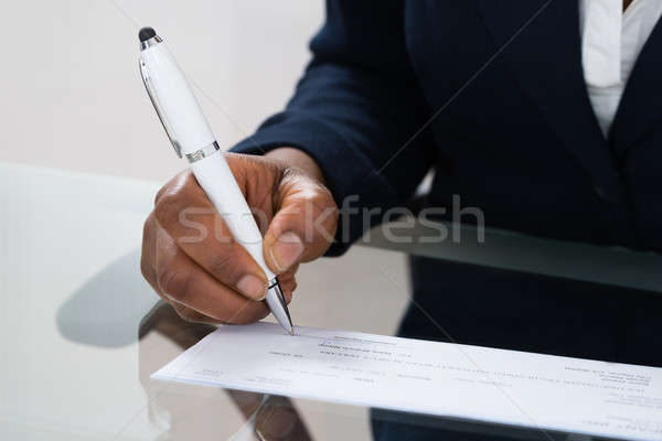 Person's Hand Signing Cheque Stock photo © AndreyPopov