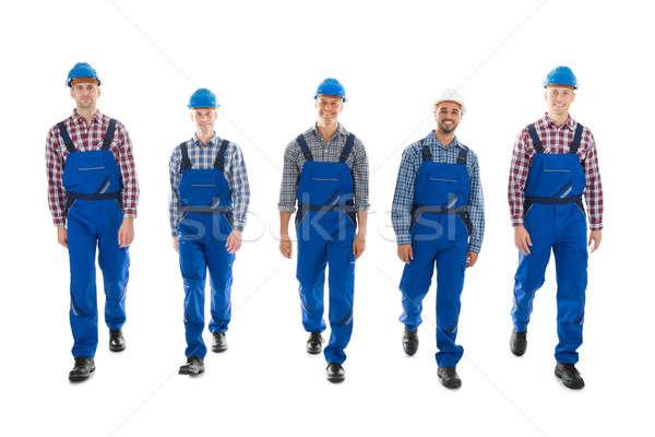 Portrait Of Confident Male Carpenters Walking In Row Stock photo © AndreyPopov