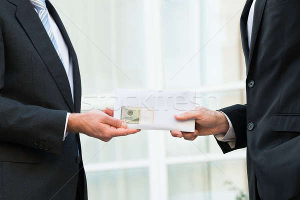 Businessman Bribing Partner Stock photo © AndreyPopov
