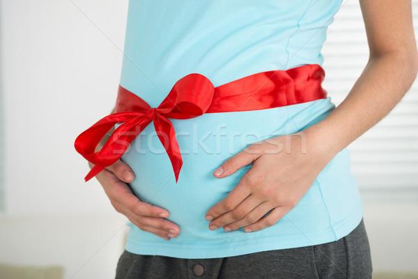 Terhes nő vörös szalag gyomor otthon szeretet anya Stock fotó © AndreyPopov