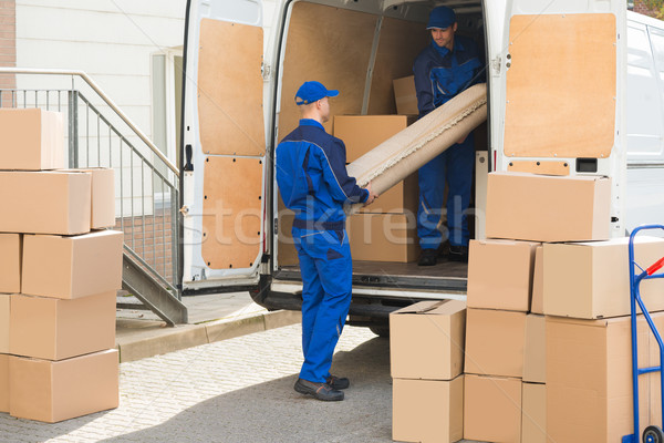 Movers Unloading Rolled Up Rug From Truck Stock photo © AndreyPopov