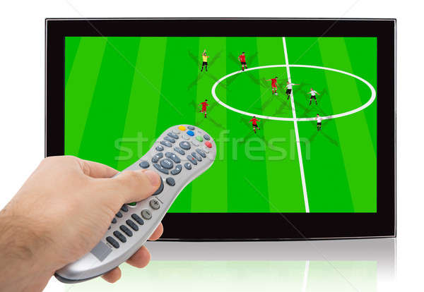 Hand Using Remote Control Of Watch Soccer Match On Television Stock photo © AndreyPopov