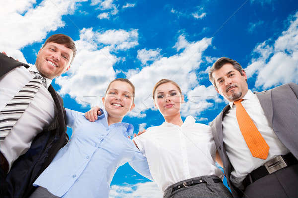 Confident Business Team Forming Huddle Against Sky Stock photo © AndreyPopov