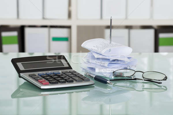 Paper Nail With Calculator And Eyeglasses Stock photo © AndreyPopov