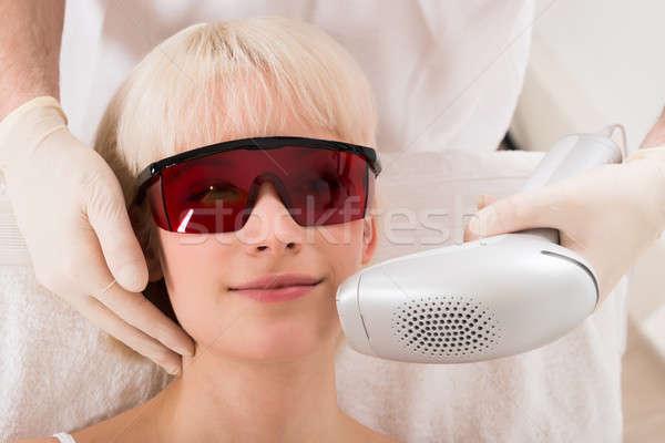 Nő lézer epiláció kezelés fürdő közelkép Stock fotó © AndreyPopov