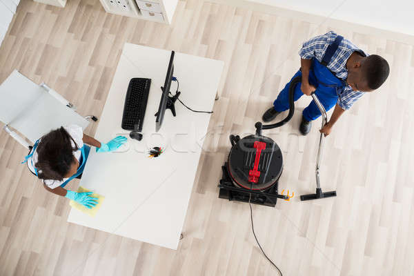 Young Male And Female Janitor Cleaning Office Stock photo © AndreyPopov