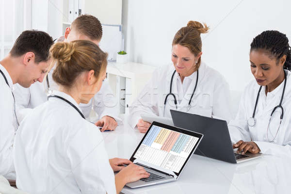 Group Of Doctors Using Laptop Stock photo © AndreyPopov