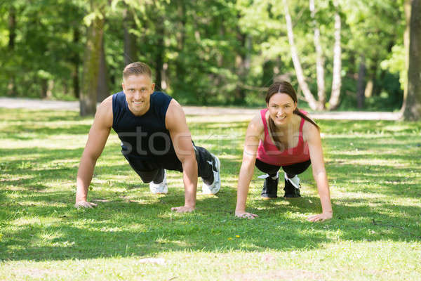 Couple Doing Push-ups In Park Stock photo © AndreyPopov