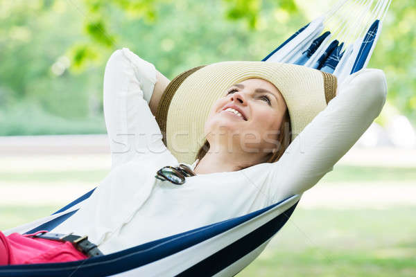 Woman Relaxing In Hammock Stock photo © AndreyPopov