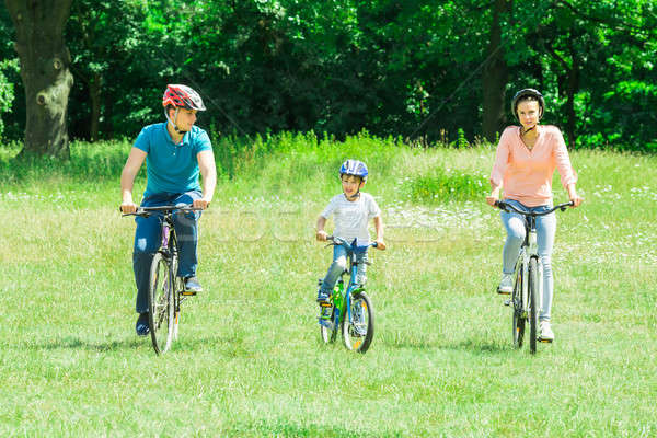 Boy With His Parent Riding Bicycle Stock photo © AndreyPopov