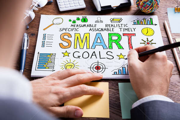 Businessperson Drawing Smart Goal Concept On Paper Stock photo © AndreyPopov