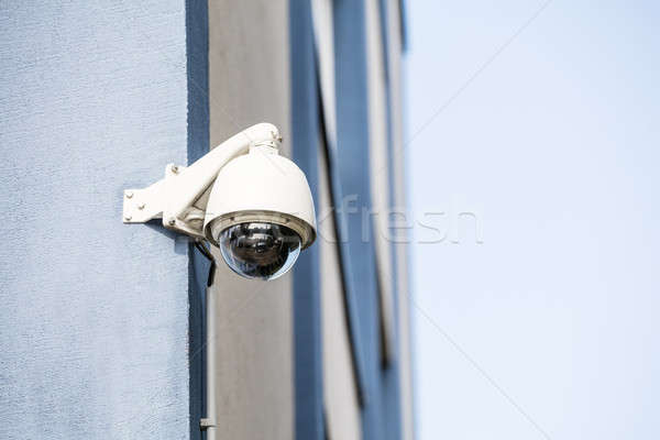 Security Camera On The Wall Of Building Stock photo © AndreyPopov