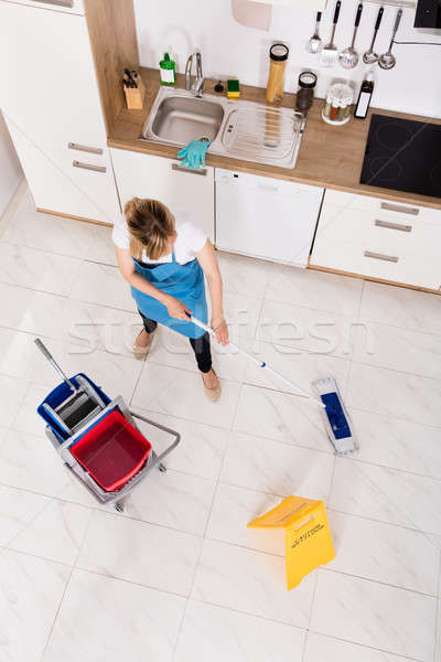 Housemaid Mopping Floor In Kitchen Stock photo © AndreyPopov
