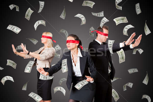 Blindfolded Businesspeople Standing In Money Rain Stock photo © AndreyPopov