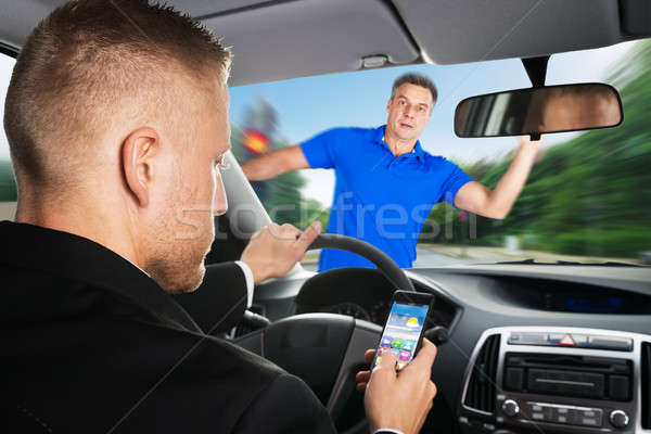 An Irresponsible Driver Causing A Car Accident Stock photo © AndreyPopov
