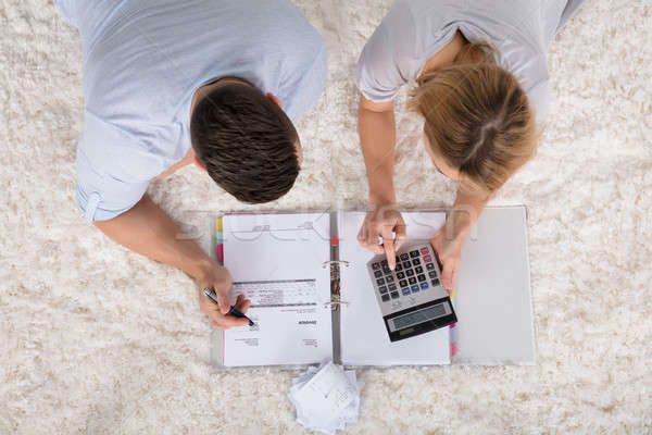Stock photo: Elevated View Of A Couple Calculating Invoice