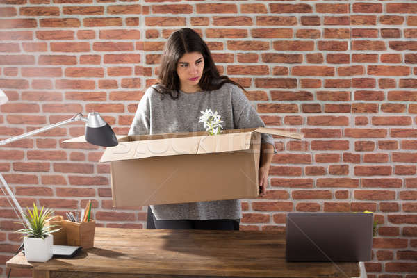 Fired Business Woman Packing Her Belongings Stock photo © AndreyPopov