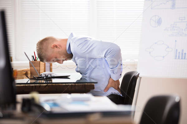 Businessman Having Back Pain Stock photo © AndreyPopov