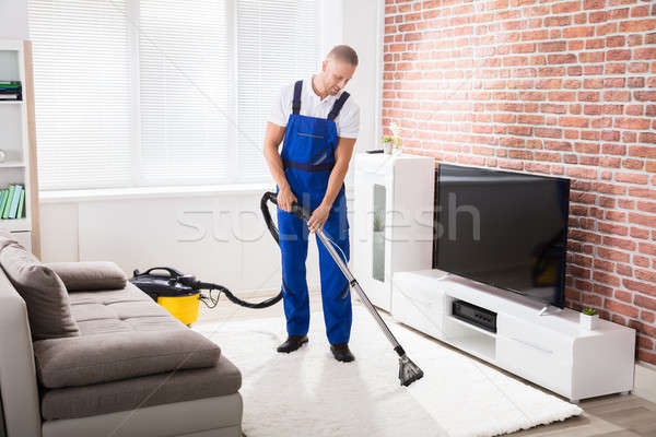 Male Janitor Vacuuming Carpet Stock photo © AndreyPopov