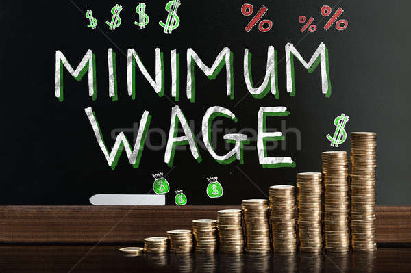 Minimum Wage At Blackboard Stock photo © AndreyPopov