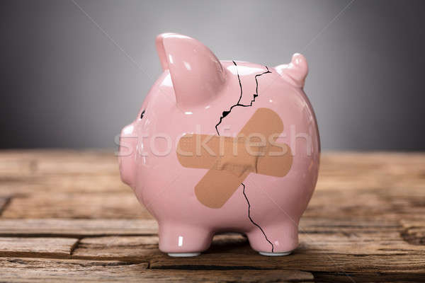 Broken Pink Piggybank With Bandage Stock photo © AndreyPopov
