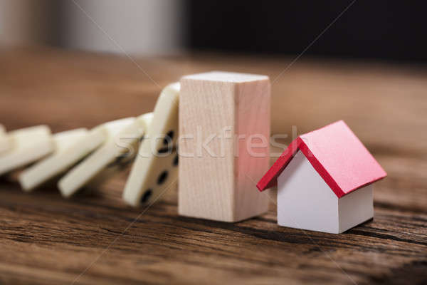 Block Stopping Domino Pieces Representing Home Insurance Stock photo © AndreyPopov