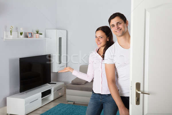 Couple Inviting People To Enter In Home Stock photo © AndreyPopov