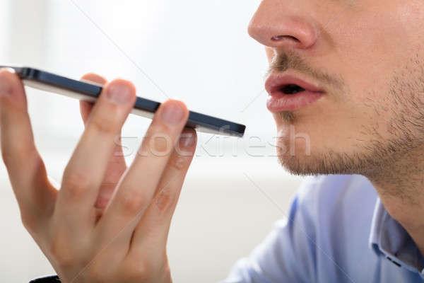 Persona voce assistente cellulare primo piano imprenditore Foto d'archivio © AndreyPopov